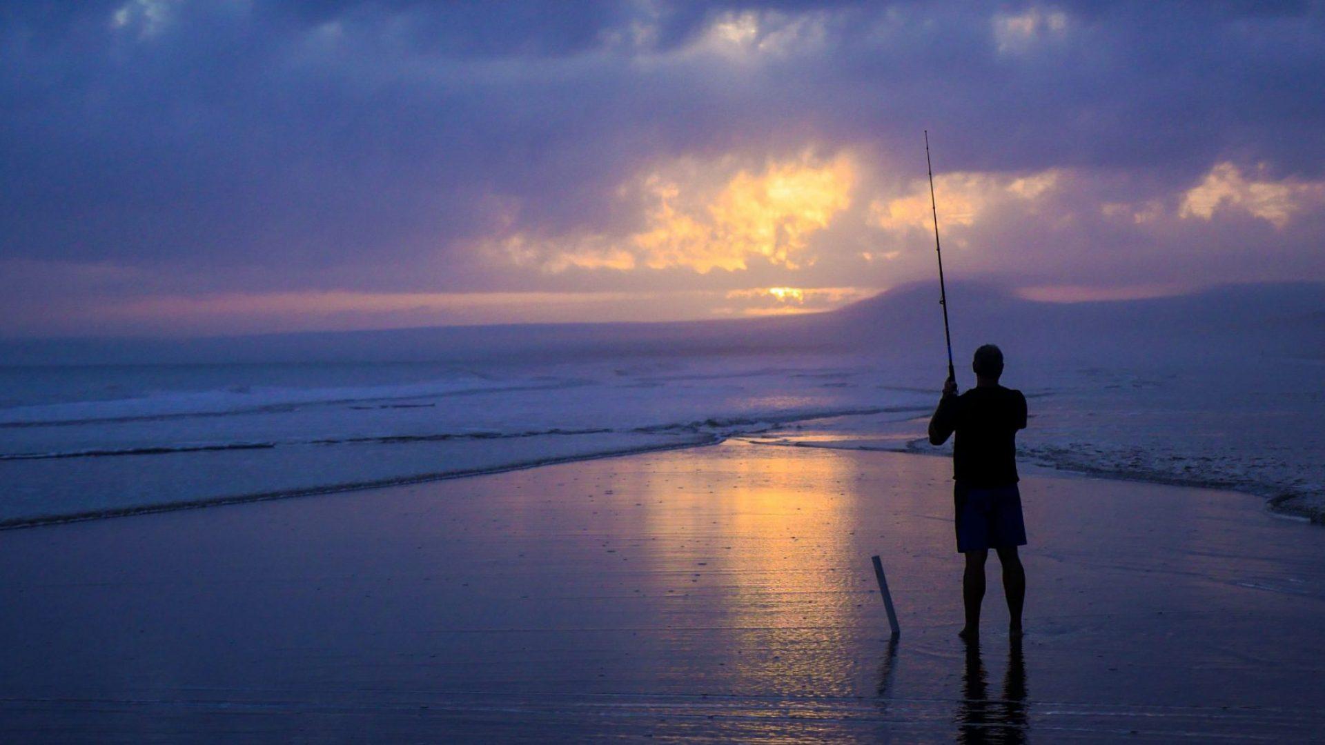 Angler am Strand - Gott kennen